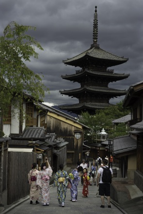 Tourists in Kyoto's Higashiyama District with a Typhoon in the distance.